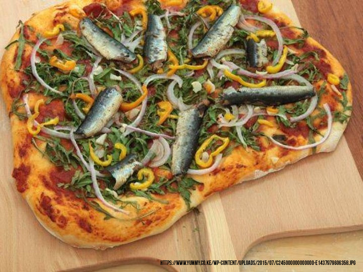 tuna, sardines, salmon, and onions pizza