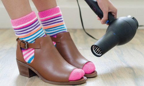 Stretch a pair of tight shoes by blow drying